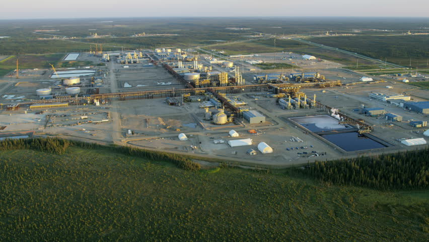 Aerial sunset view of an Oil Refinery site within Athabasca tar sands near Fort McMurray Northeast Alberta Canada RED WEAPON