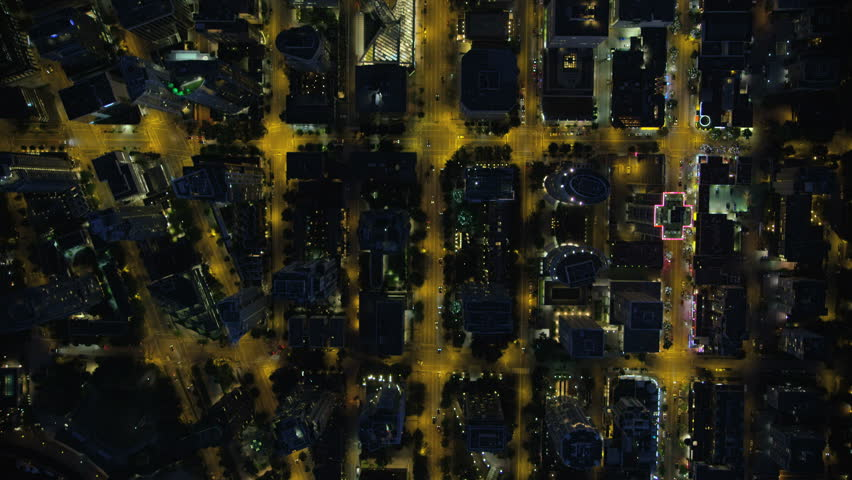 Aerial night rooftop view downtown Vancouver offices residential apartments and illuminated city street lights British Columbia Canada RED WEAPON