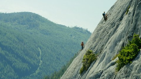 Aerial of team expedition of adventure climbers climbing Mt Habrich in Squamish area Canada RED WEAPON