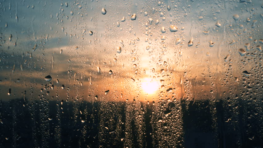 Beautiful sunrise while raining. Watching the sunrise behind the window. 4K | Shutterstock HD Video #34679131