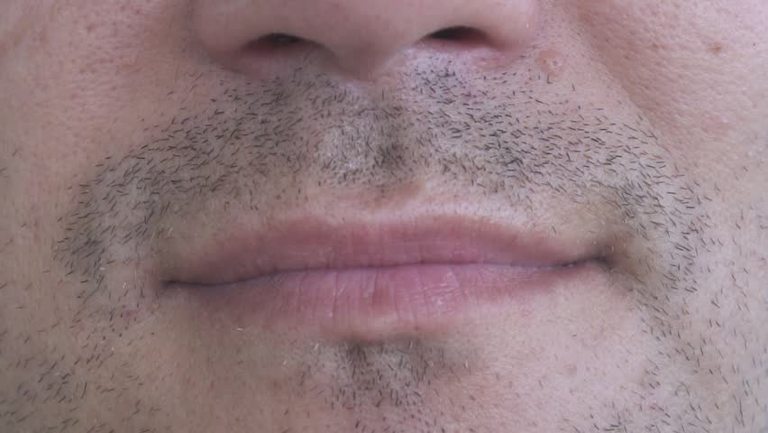 Male Lips Snort with Hmph Sound   Shutterstock HD Video #34679401