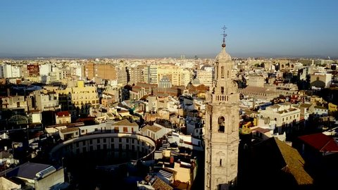 Valencia Spain aerial footage panning across Santa Catalina Church and Tower.