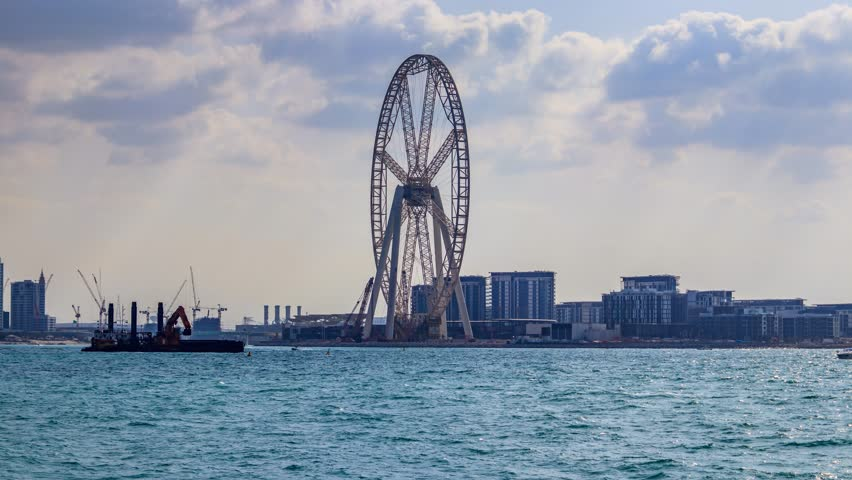 4K Timelapse Video of Dubai Eye and Dubai Ferris Wheel from Palm Jumeirah. Dubai - UAE. 5 January 2018.