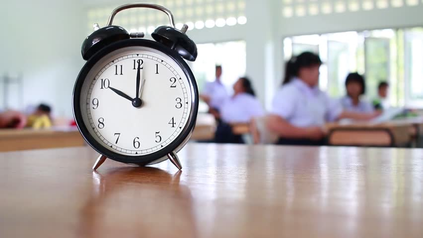 Continues indefinitely stock video footage 4k and hd video clips hd0021retro alarm clock 10 oclock left side on table teacher with earth global map graduation cap pen in blur empty classroom altavistaventures Choice Image