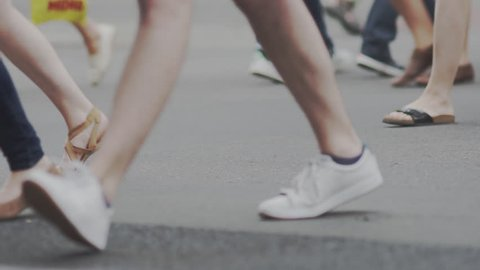 Slow Motion Shot Of People's Feet Crossing A Street In Berlin In Summer.