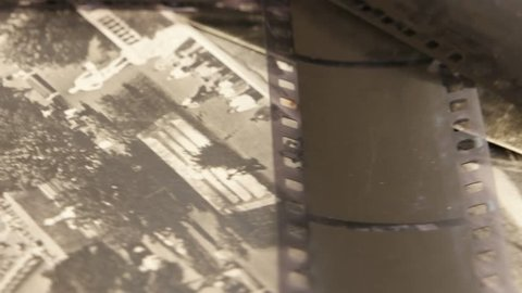 Black- and- white photographic films on the background of old black- and- white  photographs