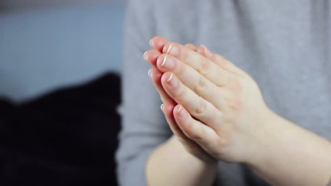Close-up of women's hands pray.