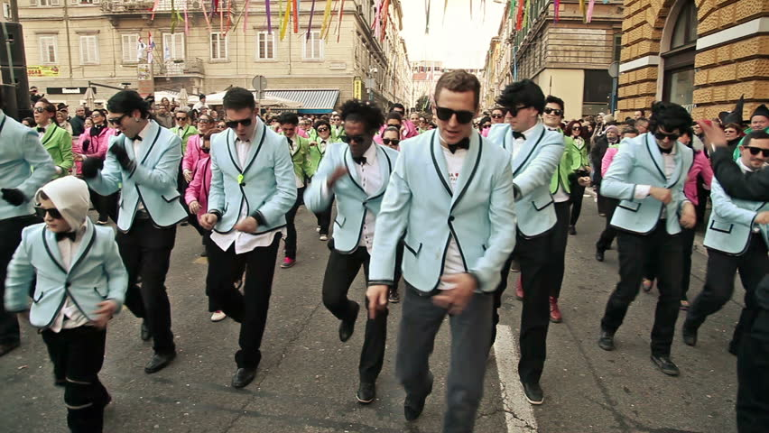 RIJEKA, CROATIA - FEBRUARY 10: Group of carnival dancers in tuxedos dance gangnam style in the street, at Rijeka Carnival on February 10, 2013 in Rijeka, one of the most popular carnival in Europe.