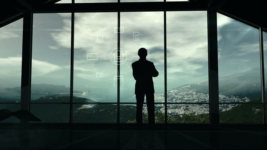 A man is standing by the window viewing IOT infographics elements | Shutterstock HD Video #34777261