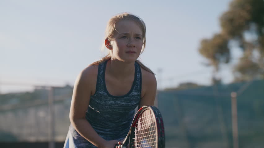 Serious portrait of young sportswoman starting her tennis match
