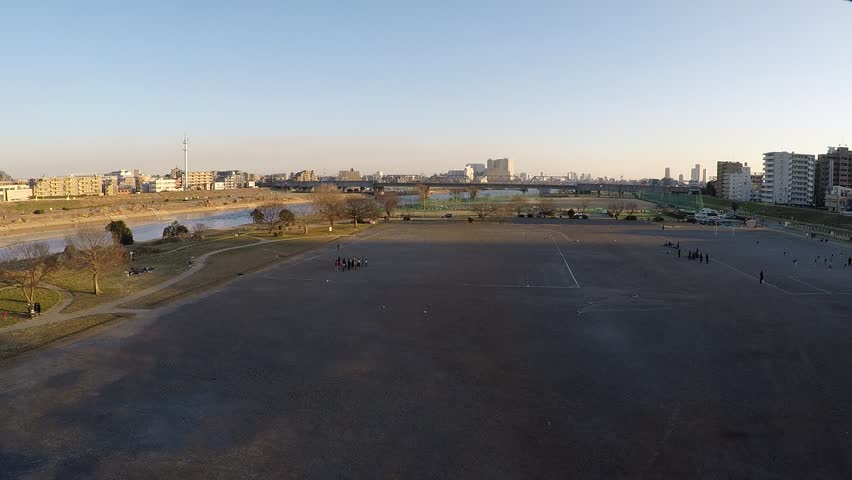 People who sports sports on the bank of the Tamagawa river | Shutterstock HD Video #34906555