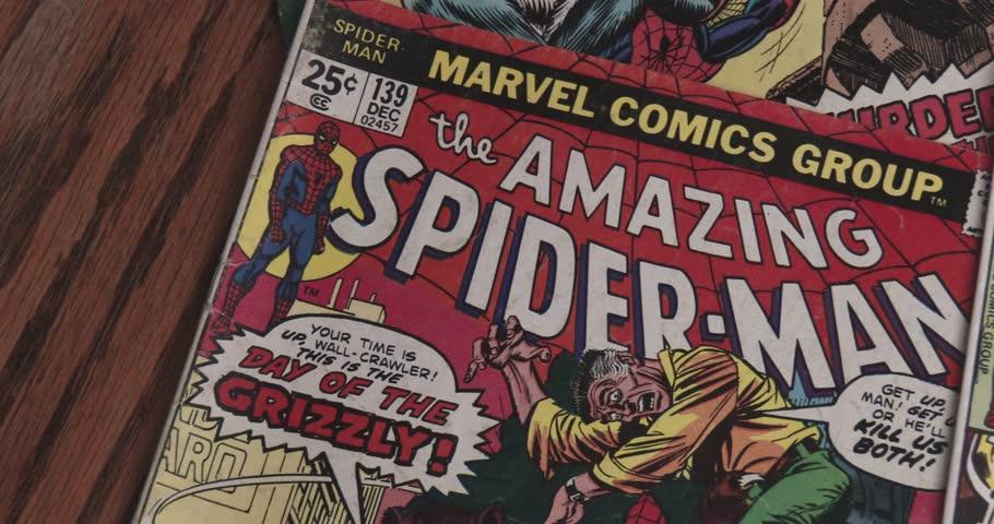 January 15, 2018, Bettendorf, Iowa, Amazing Spider Man Comic Books - Close Up Pan - Vintage   Shutterstock HD Video #34919881