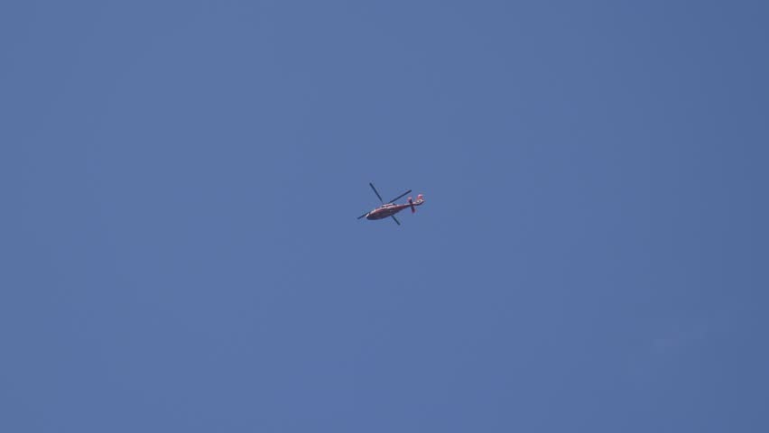 Rescue helicopter flying high in the sky
