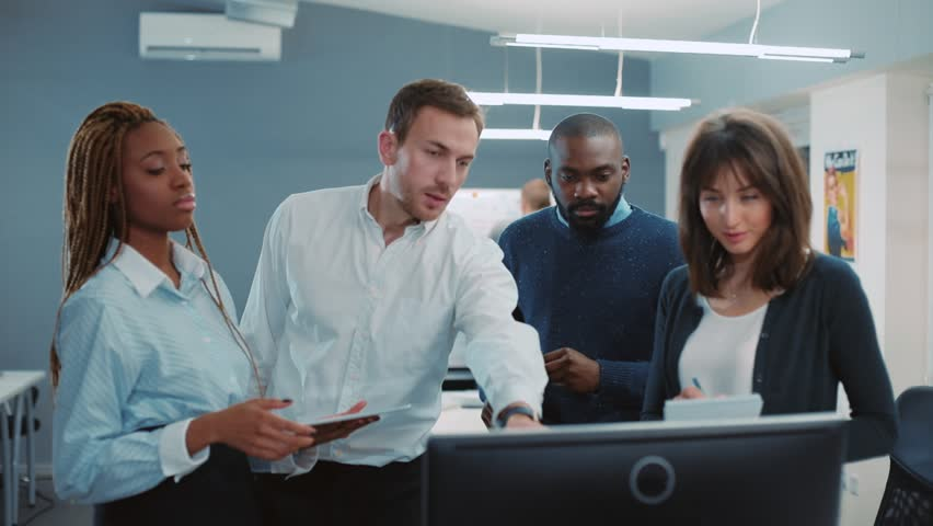 Chief and three colleagues standing and looking at computer screen in beautiful modern office with new repair. People looking at camera and smiling. Director folding arms over chest. | Shutterstock HD Video #34937707