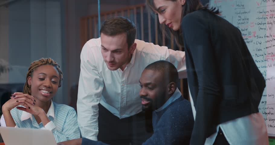 Four employees of prestigious international firm discussing about future deal. Beautiful young African girl suggesting to make some important terms in contract. Close-up. Evening. | Shutterstock HD Video #34937731