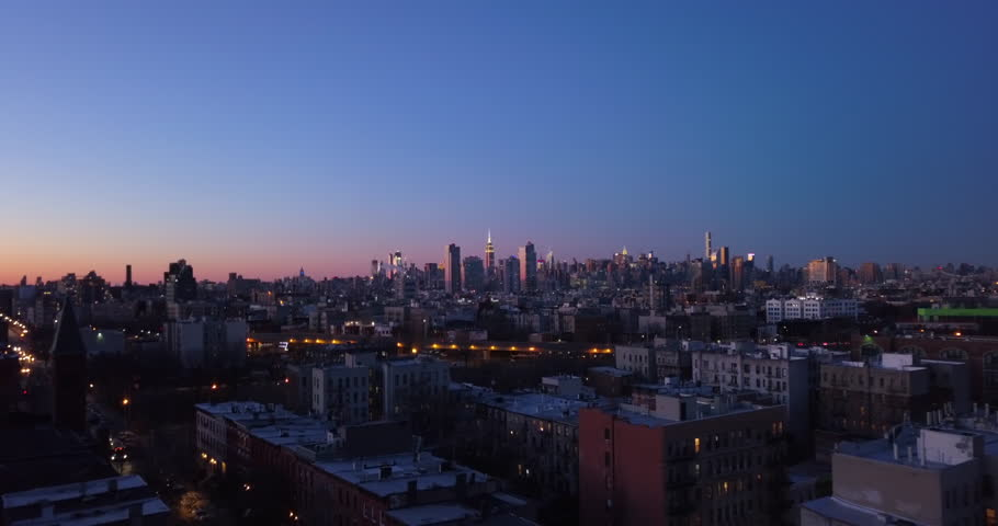 New York City Skyline buildings at dusk shot from aerial drone in 4k covering Brooklyn, Queens, and Manhattan   Shutterstock HD Video #34943086