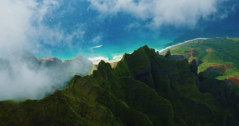 Cinematic aerial view of dramatic mountains and ocean on Napali Coast, Kauai, Hawaii