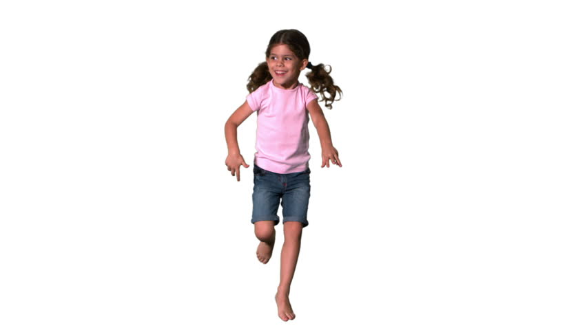 Cute little girl jumping on white background in slow motion
