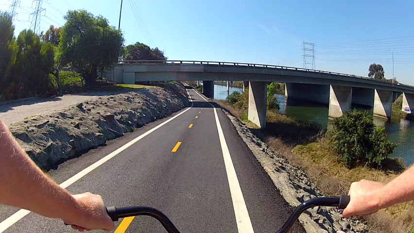 LONG BEACH, CA - February 23, 2013: The POV of someone riding a bicycle under