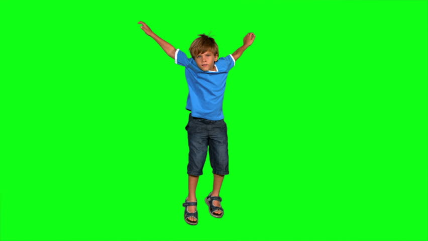 Boy jumping on green screen in slow motion #3502061