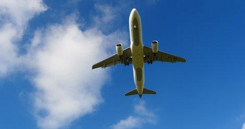 4K Ultra HD 4K+ shot of aircraft takeoff plane fly over close beautiful shot blue sky.