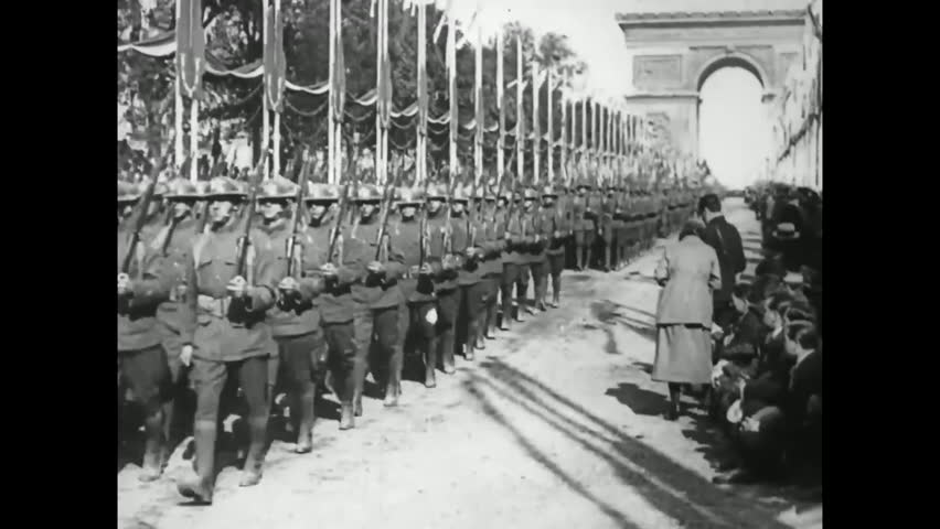 CIRCA - 1918, 1919 - American troops march before General Pershing, and the Victory Parade in Paris on July 14, 1919.