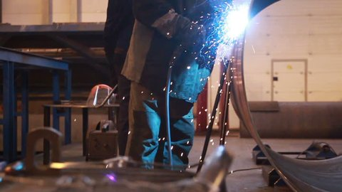 Welder at work on the plan. sequence.