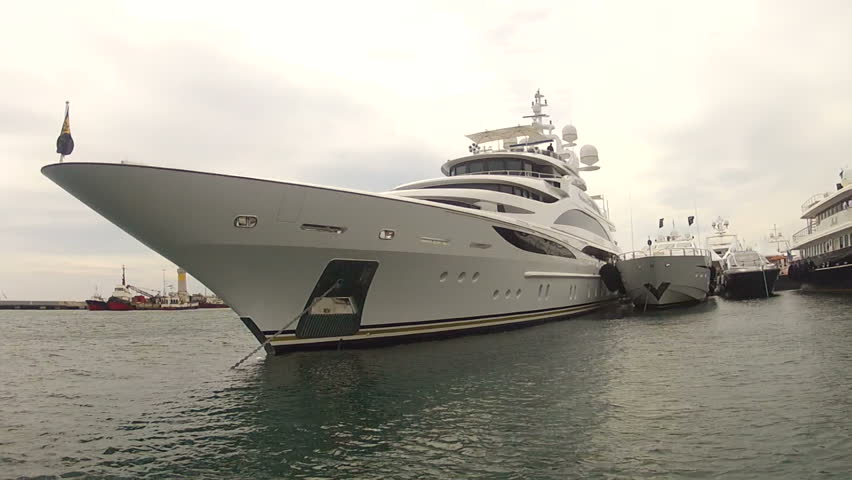 cruising past bow of large Super Yacht in Cannes, France