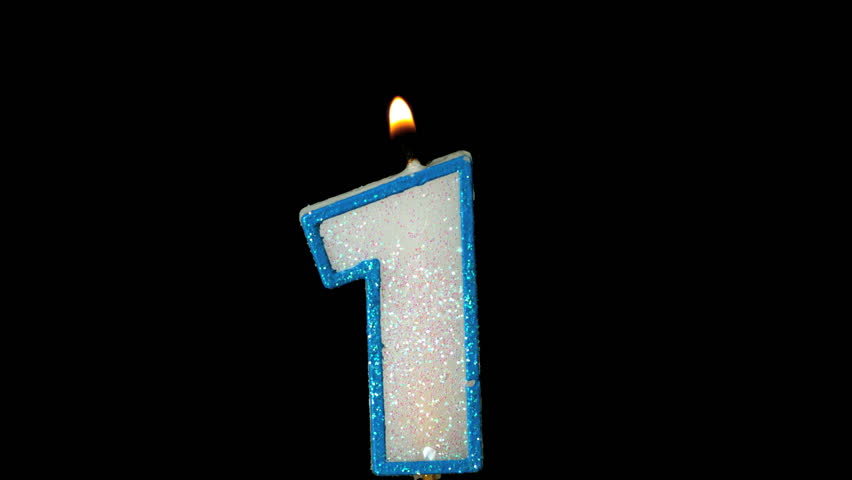One Birthday Candle Flickering And Extinguishing On Black Background In Slow Motion
