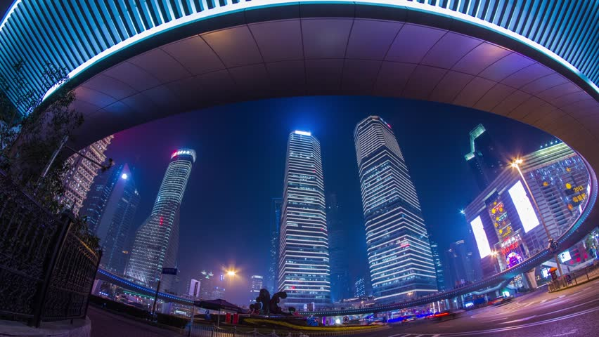 SHANGHAI - CIRCA 2013: Time Lapse of Night view of the IFC buildings under the Pedestrian Ring in Pudong, Shanghai, China. It was a Cloudy night with crowds traffic and automobile traffic