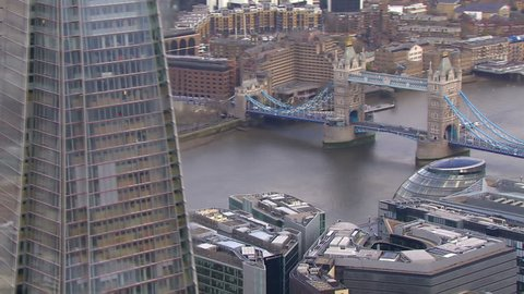 Aerial view of the iconic landmark that is Tower Bridge which crosses the River Thames in London. London's tallest building can also be seen.