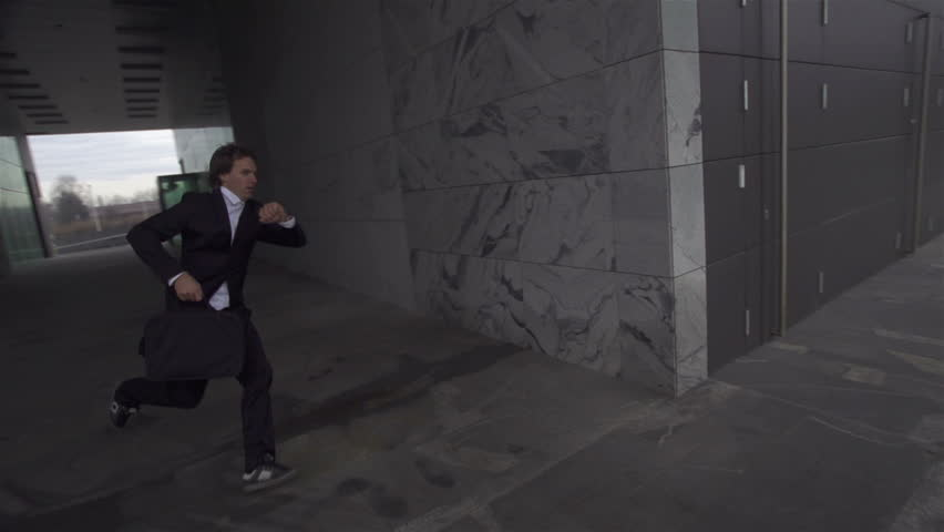 SLOW MOTION: Late businessman is running to a meeting