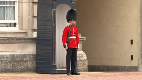 LONDON, UK - AUGUST 12: A royal guard at Buckingham Palace which will be the starting point of the royal wedding procession to be held, 2011 in London, United Kingdom