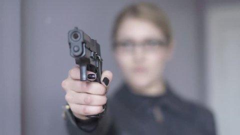 women officer using gun. undercover agent. female police. crime criminal. close up. shot in slow motion.
