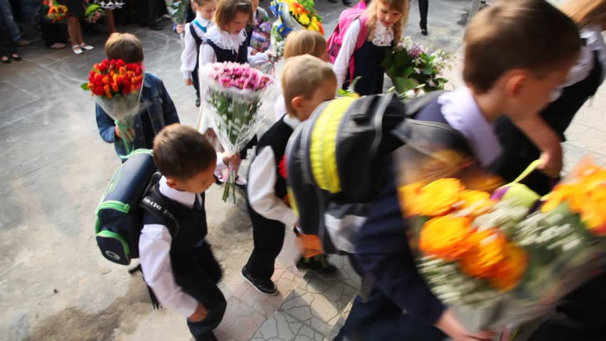 MOSCOW - SEP 1: Children with flowers for first day enter the school, on sept 1, 2011 in Moscow, Russia.