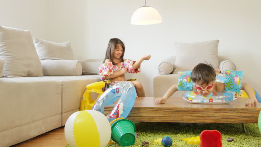 Kids Playing In The Living Room, Fantasize They Are On A Beach.   HD