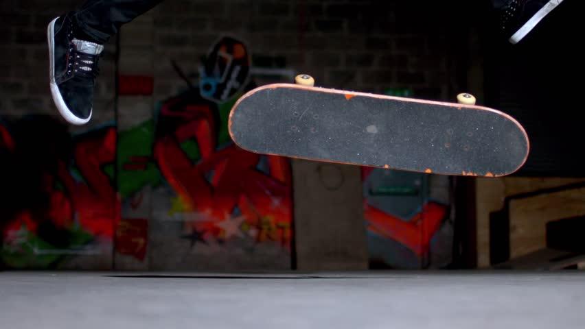 Close up of skater doing 360 flip trick in slow motion