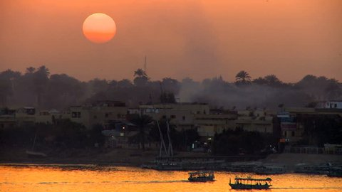 View of Nile river at sunset with Felucca traditional sailboats near Luxor in Egypt
