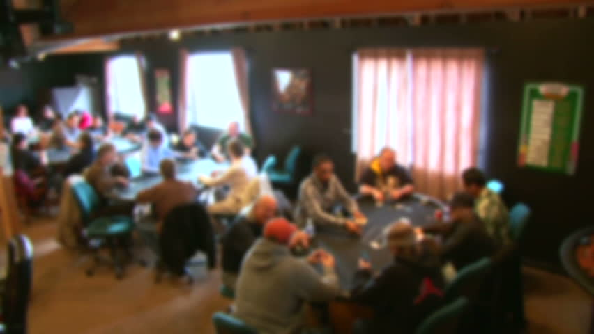 Soft focus, unrecognizable people in poker club gambling at poker card tables, panning shot. | Shutterstock HD Video #3625571