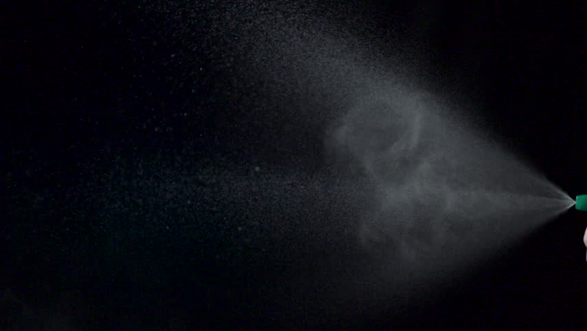 Using spraying bottle and cleaning on black background shooting with high speed camera, phantom flex.