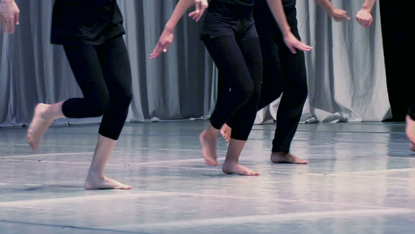 Contemporary choreography. Men and women dressed in black dancing barefoot. Slow Motion at a rate of 240 fps
