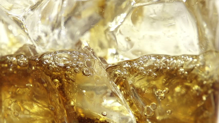 Close up view of the ice cubes in cola background