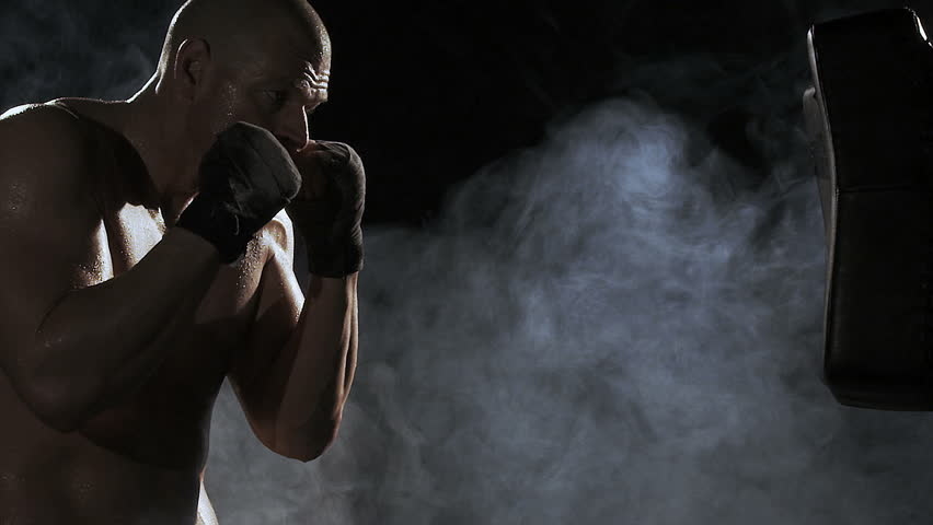 Kickboxer shadow boxing as exercise for the big fight, shot on Red Epic