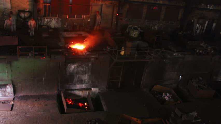 Putting iron in the furnace to melt, time lapse