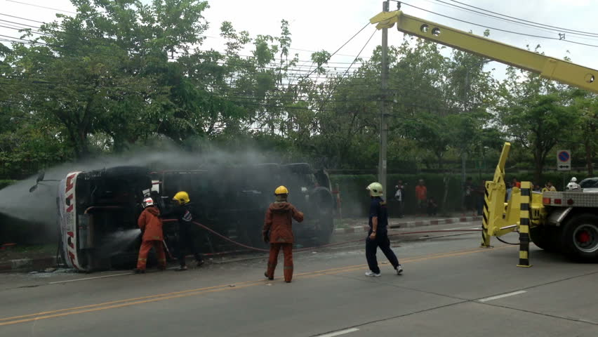 BANGKOK - APRIL 15: A rolled-over gas truck is being craned back on wheel in Bangkok, Thailand, on April 15, 2013. The gas truck crashed after a brake failure