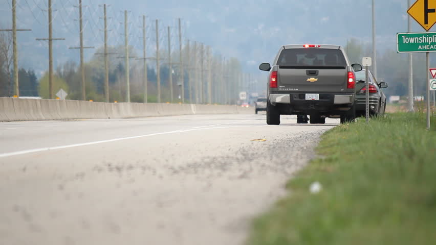 ABBOTSFORD, BRITISH COLUMBIA - APRIL 7: An unmarked police car pulls over a speeding vehicle to issue a ticket near Abbotsford, British Columbia on April 7, 2013.