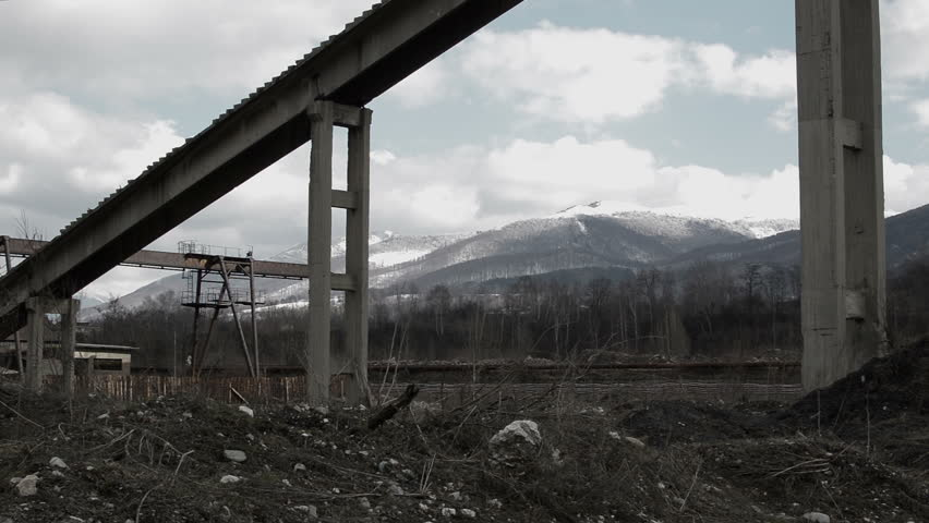 Abandoned mining buildings in  post apocalyptic looking industrial area