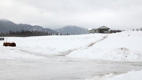 Man slipping on ice on a ranch in Montana