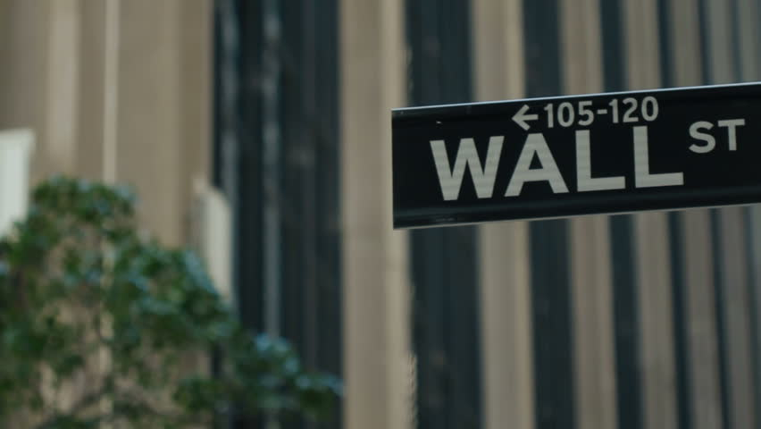 Wall Street, New York, USA - tracking reveal of road sign