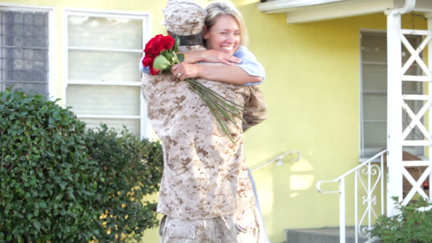 Stock video of wife rushes to greet army husband | 3778301 ...